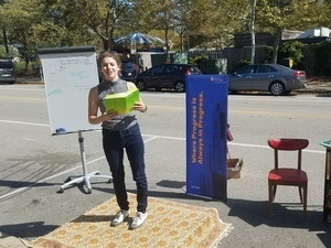 photo of poetry reading in a parking space