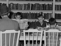 """In the library of the FSA (Farm Security Administration) farm families community. Yuma, Arizona."" Photograph by Russell Lee, 1942."