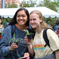Two girls enjoying Earth Day 2019 with free plants