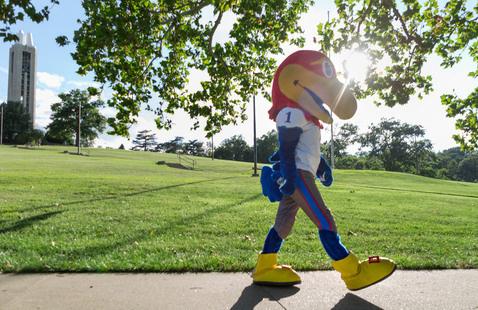 Football Big Jay walking past Campanile