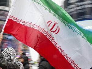 Man carries Iranian flag