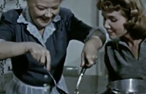 An image of two people cooking.