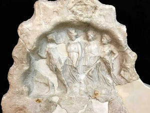 Marble sculpture woth four small figures inside.
