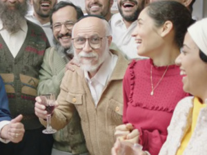 Image from the film of a  crowd of people laughing and smiling.