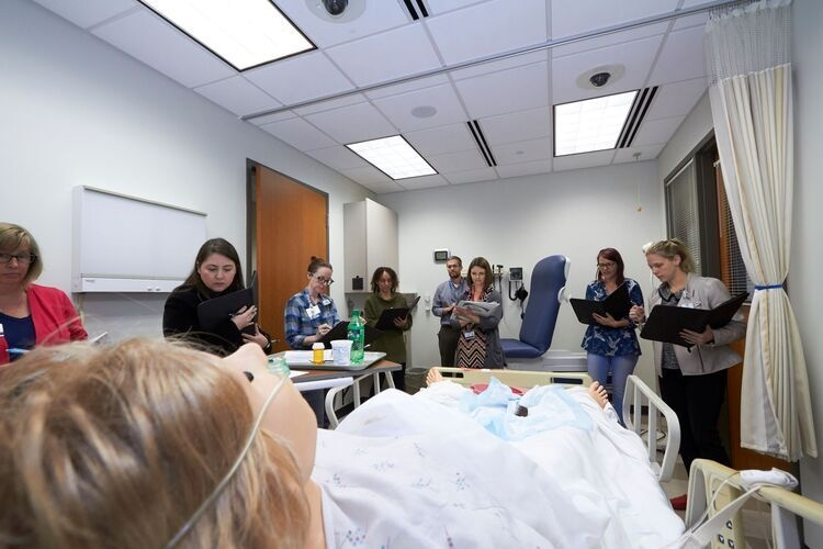IPE 101 participants in the Room of Horrors simulation