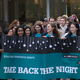 A picture of students carrying a Take Back the Night banner.