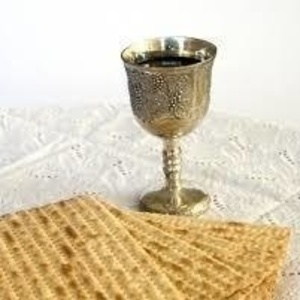 cup of wine and matzah