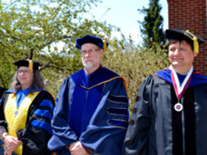 Professors dressed in regalia for commencement