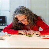Judith Schaechter at work in her studio