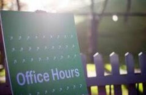 Green bulletin board with text reading 'Office Hours'