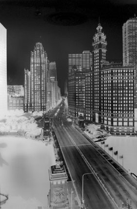 A Photo Negative Image created by Vera Lutter using a camera obscura. The scene is a Chicago skyline—it looks like an X-Ray of Skyscrapers. Buildings have lots of bones inside of them.