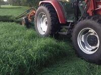 Tactor in hay field