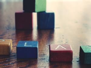 "photo of blocks spelling ""play"""