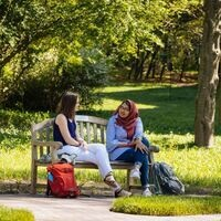 Undergrad students on campus bench