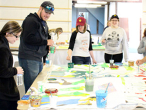 Students painting mural panels