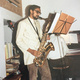 Throwback photo of Shashi Kanbur playing saxophone