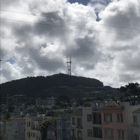 cloudy day with Mt Sutro tower over apartments