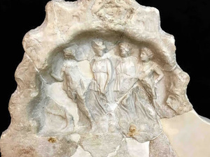 marble sculpture  in shape of crown with four figures cared inside.