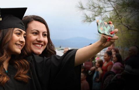 Graduates taking a selfi