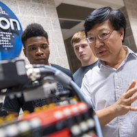 Students and faculty working in the OMRON mechatronics engineering lab. Hands-on experience starting freshman year is what sets NIU's CEET apart from the rest..