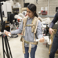 Students have the opportunity to get hands-on experience in our labs. Here a student is working in the biomedical engineering lab with an exoskeleton.