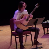 OCA_at_SOU_Music_Student_Taran_McGuire_playing_guitar