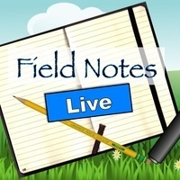 Notebook on a grassy field; title Field Notes Live