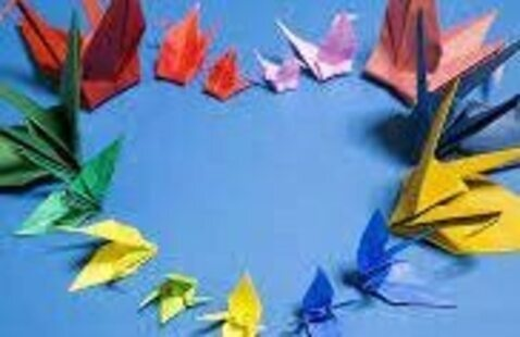 picture of origami peace cranes forming a heart