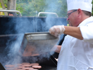 Chartwells chef grilling burgers for the Big Bang!