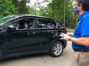 Campus President Robert Gregerson greets guests on the Drive-Thru Tour