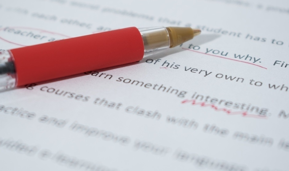 Red pen and grammatical corrections on typed page