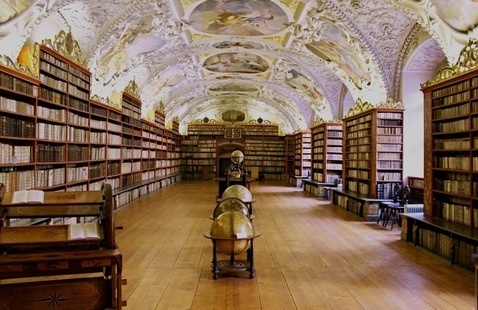Library filled with old books and globes
