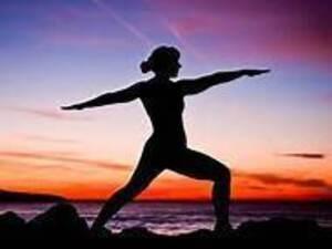 woman doing yoga in sunrise