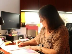 Counseling Director at her desk