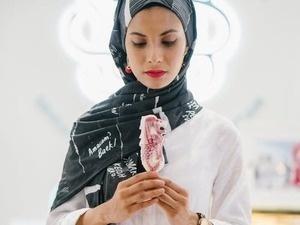 woman in hijab eating ice cream