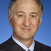 The Honorable Bruce Reinhart