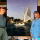 Chris Murphy and artist Jeanne Staples in front of her painting of Chris sailing historic catboat 'Vanity'