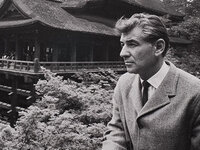 Leonard Bernstein in Japan looking out at a Japanese house and garden.