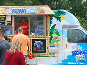 Kona Ice Truck with customers at past event.
