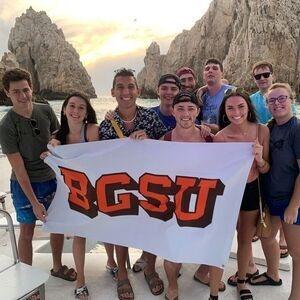 Students holding BGSU flag