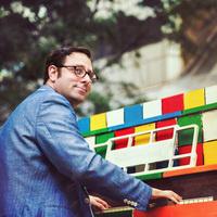 photo of Ethan Uslan playing a piano