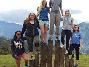 Students in Pitt gear abroad