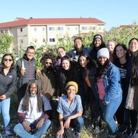 Group of multicultural students and farmers on a tour of city gardens