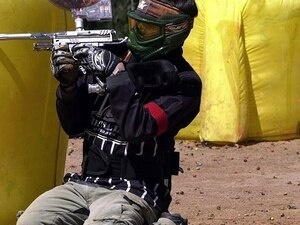 student playing paintball