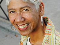 ERICKA HUGGINS  - THE BLACK PANTHER PARTY AND ITS COMMUNITY SURVIVAL PROGRAMS