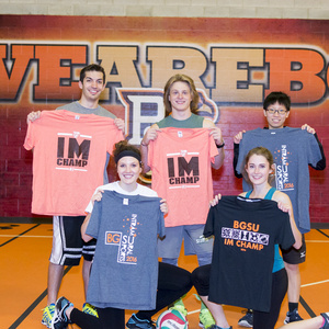 Winners of four player volleyball holding up their Intramural T-shirts
