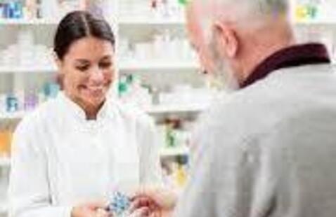 A pharmacist assisting a customer