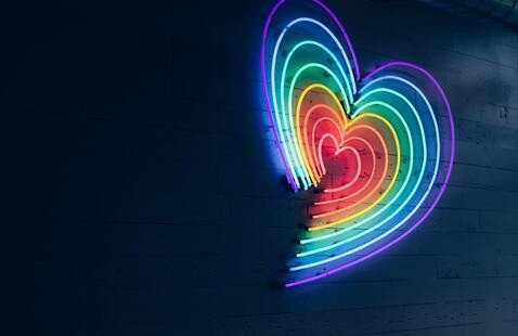 neon light in the shape of a heart with a spectrum of colors