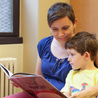 Mother reading a book to a child