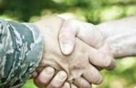 A veteran shaking hands with an employer